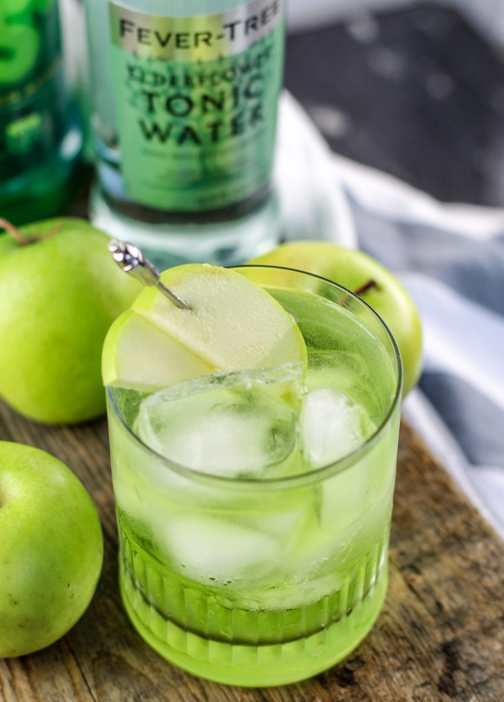 Irish Sour Apple Cocktail Recipe perfect for St. Patricks Day Parties! This green cocktail recipe is so easy to make. Celebrate St. Paddys in style!