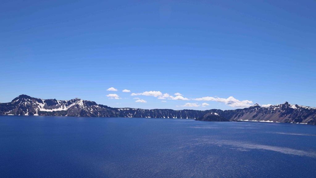 Crater Lake National Park is located in Oregon. My travel tips include park facts, camping and lodge information, closest airport and how to get there, visitor center locations and park hours.