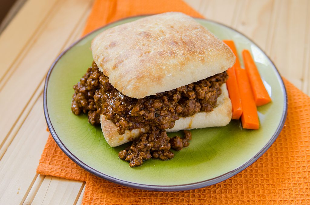 Easy Homemade Crock Pot Sloppy Joes Recipe with a bit of spiciness. The slow cooker does all the work! This is hands down the best slow cooker Crock Pot Sloppy Joes Recipe ever! It is an easy to make homemade recipe that will have everyone who loves a little spice in their life coming back for more!