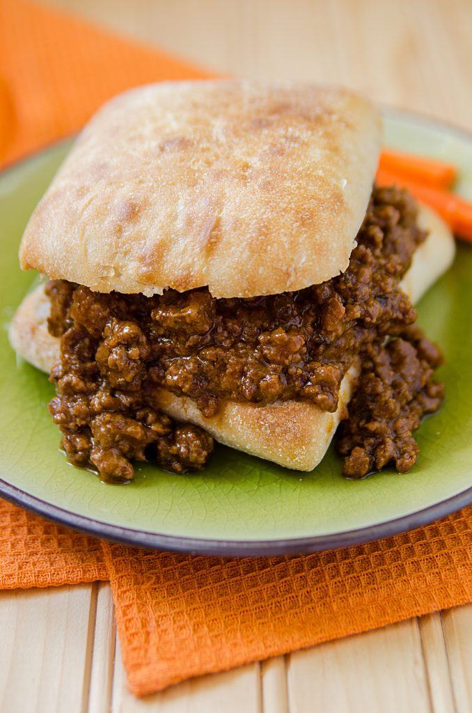 Easy homemade slow cooker crock pot spicy sloppy joes great for a crowd. This is hands down the best slow cooker Crock Pot Sloppy Joes Recipe ever! It is an easy to make homemade recipe that will have everyone who loves a little spice in their life coming back for more!