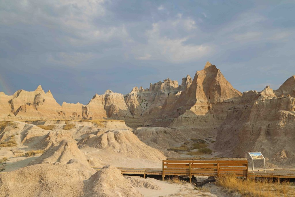 Things to do at Badlands National Park in South Dakota include Road Trips/Auto Touring, Photography, hiking, where to see sunrise and sunset, wildlife viewing plus visit nearby Wall Drug and Minuteman Missile National Historic Site. #badlands #nationalparks #blackhills #southdakota