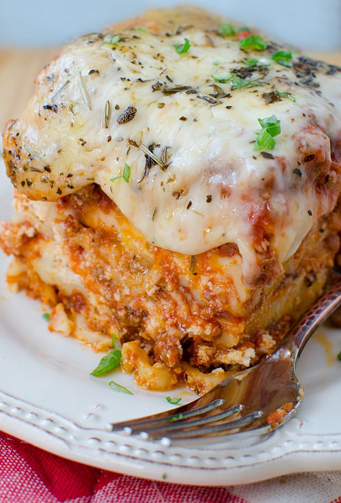 Easy crock pot lasagna recipe with beef! The slow cooker does all the work.