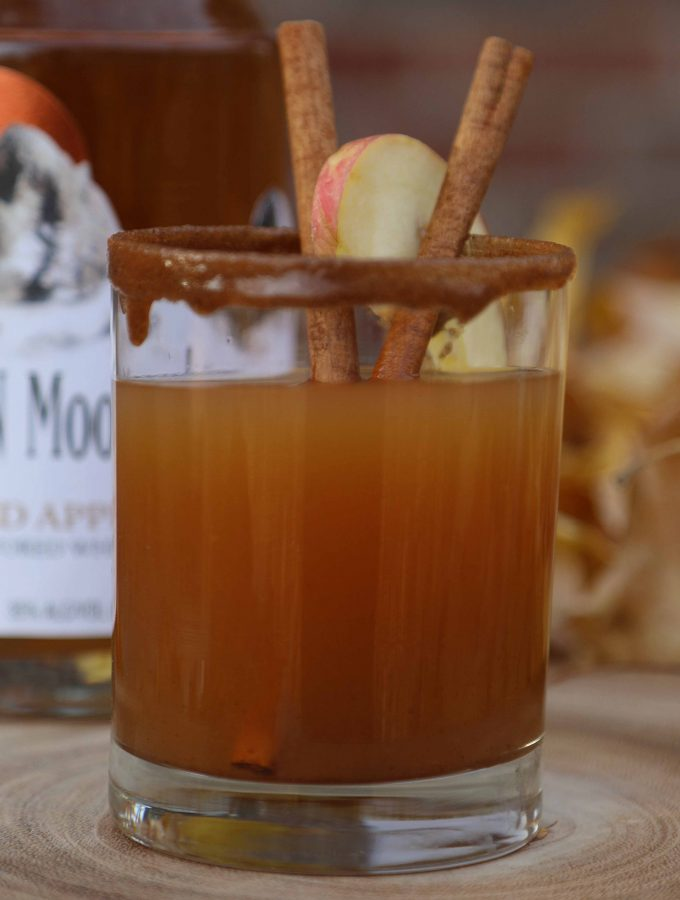 This Spiced Apple Pie Cocktail has all the classic fall drinks flavors everyone loves including apple, caramel, and cinnamon. It's like fall in a glass!