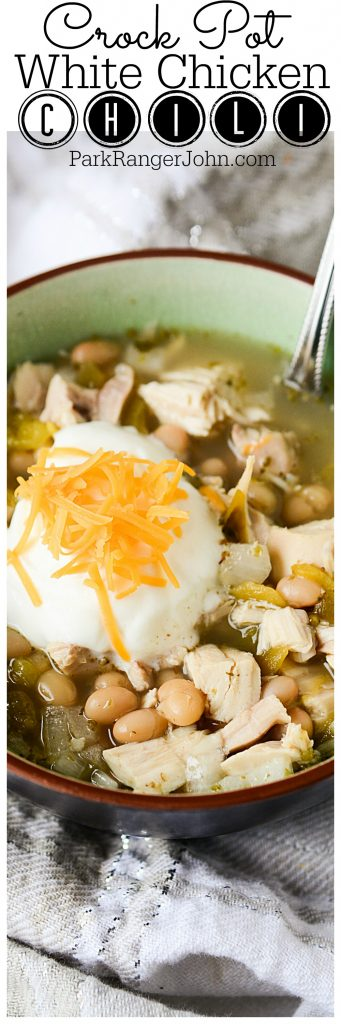 Super easy slow cooker Crock Pot White Chicken Chili Recipe. Chili is a great comfort food, especially in the winter after spending the day outdoors. You and your family will all go for seconds for this creamy deliciousness! #crockpot #slowcooker #chicken #chili #comfortfood
