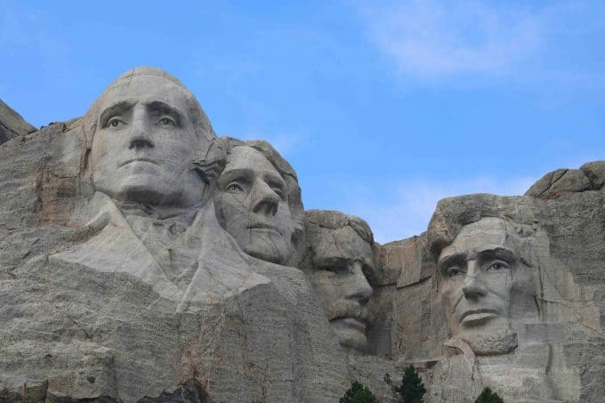 Close up photos of the four presidents carved in Mount Rushmore