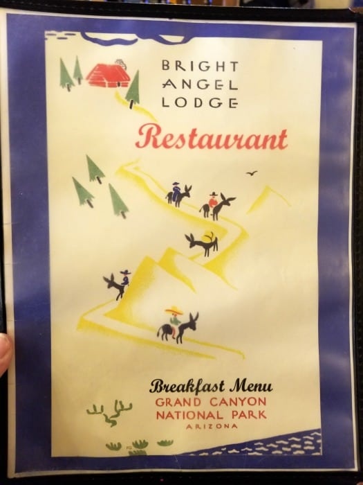 Front cover of the restaurant menu with a cartoon of donkeys going into the Grand Canyon