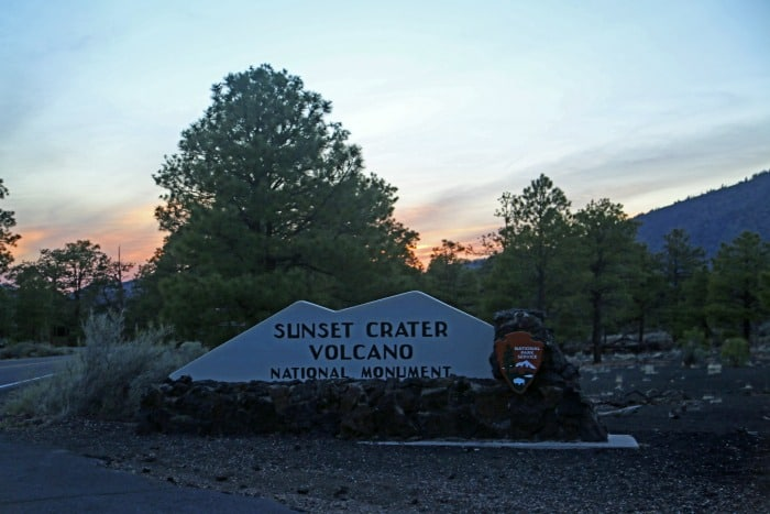 Sunset Crater Volcano National Monument entrance sign at sunset