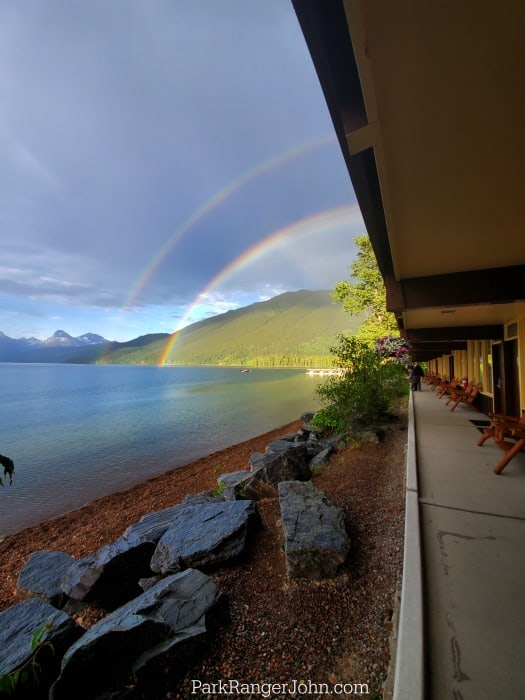 Double rainbow in the distance over Lake McDonald, Glacier National Park